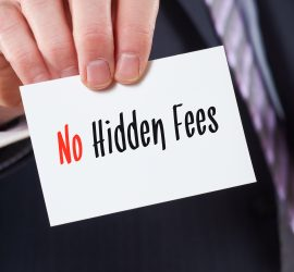 A businessman holding a business card with the words, No Hidden Fees, written on it.